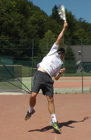 Top spin serve tip