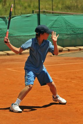 The forehand stroke technique of a junior tennis player